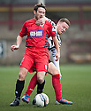 Shire's Iain Thomson gets a grips of Queen's Park David Anderson.