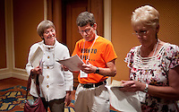 Susan Hartner (cq, left), from Hillsboro, Oregon, Scott Firebaugh (cq, middle), from Knoxville, Tennessee, and Richelle Cross (cq, right), from Brighton, Colorado, check their scores on the written portion of the AARP National Spelling Bee to see if they made it into the final round of the bee at the Little America Hotel in Cheyenne, Wyoming, Saturday, June 18, 2011. Both Susan and Scott made it to the finals. ..Photo by Matt Nager
