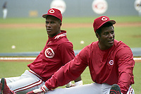 Cincinnati Reds Ken Griffey (right) and Eric Davis stretch before a game against the Atlanta Braves circa 1989 at Atlanta-Fulton County Stadium in Atlanta, Georgia.  (MJA/Four Seam Images)