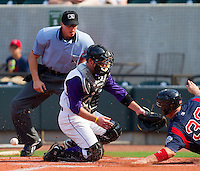 Catcher Logan Johnson #32 of the Winston-Salem Dash can't hold onto the ball as Ryan Lavarnway #33 slides around him at  BB&T Ballpark June 27, 2010, in Winston-Salem, North Carolina.  Photo by Brian Westerholt / Four Seam Images