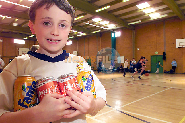 Adam reilly having a refreshing break at the basketball camp in the Secred Heart School sponsored by Drogheda concentrates.Picture Fran Caffrey Newsfile...This Picture is sent to you by:..Newsfile Ltd.The View, Millmount Abbey, Drogheda, Co Louth, Ireland..Tel: +353419871240.Fax: +353419871260.GSM: +353862500958.ISDN: +353419871010.email: pictures@newsfile.ie.www.newsfile.ie