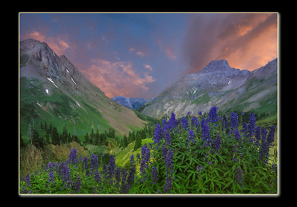 Photoshop. Flopped the image and inserted a sunset over a gray sky. Yankee Boy Basin, Ouray, Colordao.