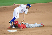 Round Rock Express shortstop Omar Qunitanilla #3 tags out Memphis Redbird baserunner Adron Chapman during a game against the Memphis Redbirds at the Dell Diamond on July 7, 2011in Round Rock, Texas.  Round Rock defeated Memphis 6-4.  (Andrew Woolley / Four Seam Images)