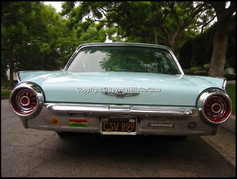 BNPS.co.uk (01202 558833)<br /> Pic: BeverlyHillsCarClub/BNPS<br /> <br /> ***Please Use Full Byline***<br /> <br /> The back of the car.<br /> <br /> A classic Ford Thunderbird car owned by late Clash frontman Joe Strummer has emerged for sale for a mystery sum.<br /> <br /> The rock legend bought the plush motor in 1987, splashing out just 4,200 dollars for it when he moved to the USA in the wake of the band's break-up.<br /> <br /> A huge fan of American cars, Strummer - the genius behind The Clash's biggest hits such as Rock the Casbah, London Calling and Should I Stay of Should I Go - drove the 1963 Thunderbird right up until his untimely death in 2002.<br /> <br /> Following Strummer's sudden death aged 50 from undiagnosed heart problems the car was passed to his publicist.<br /> <br /> The car, which has done 420 miles on its current engine, is now being sold on eBay by the California car dealers Beverly Hills Car Club.