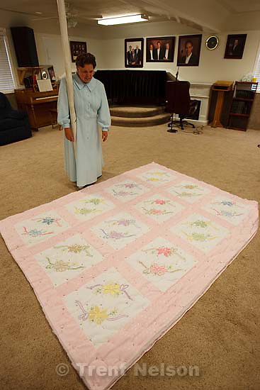 Westcliffe - . Monday, July 28, 2008. woman with quilt