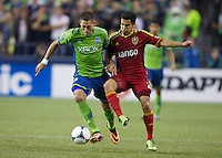 Clint Dempsey, left, of the Seattle Sounders FC battles Tony Beltran of Real Salt Lake for the ball during play at CenturyLink Field in Seattle Friday September 13, 2013. The Sounders won the match 2-0.
