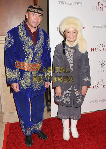 LOS ANGELES, CA - OCTOBER 18: Subjects of the film Nurgaiv Rys (L) and Aisholpan Nurgaiv arrive at the Premiere Of Sony Pictures Classics' 'The Eagle Huntress' at Pacific Theaters at the Grove on October 18, 2016 in Los Angeles, California.<br /> CAP/ROT/TM<br /> &copy;TM/ROT/Capital Pictures