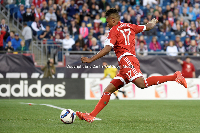 May 23, 2015 - Foxborough, Massachusetts, U.S. - New England Revolution forward Juan Agudelo (17) takes a shot on the net during the MLS game between DC United and the New England Revolution held at Gillette Stadium in Foxborough Massachusetts. The New England Revolution and D.C. United ended the game tied 1-1.  Eric Canha/CSM