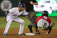 Round Rock Express shortstop Luis Sardinas (15) waits for a throw as Oklahoma City RedHawks base runner Andrew Alpin (8) slides into second base during the Pacific Coast League baseball game on August 1, 2014 at the Dell Diamond in Round Rock, Texas. The Express defeated the RedHawks 6-5. (Andrew Woolley/Four Seam Images)