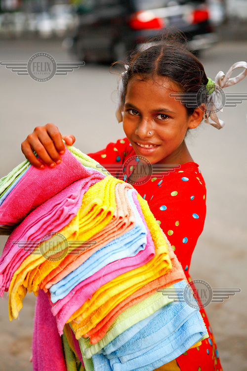 A girl sells towels outside Dhaka's biggest shopping centre, Bashundhra City, Panthapath.