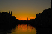 The Grand canal at dawn, with church tower reflected in the canal waters, Venice. Ray Atkins.