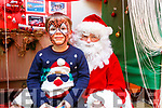 Samual Enright with Santa Clause at the Gaeil Scoil Mhic Easmainn Food fair in the school on Sunday