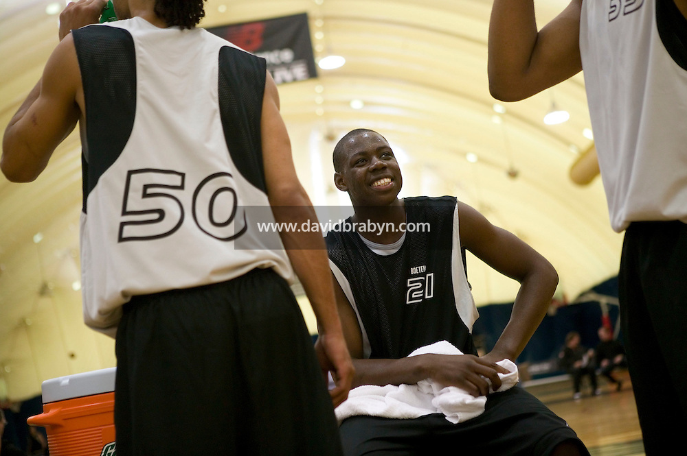 Eric Boateng (C) jokes with teammates during a break in a practice game at the Basketball City complex in New York City, United States, 14 April 2005, preparing for the 2005 Jordan Classic game.