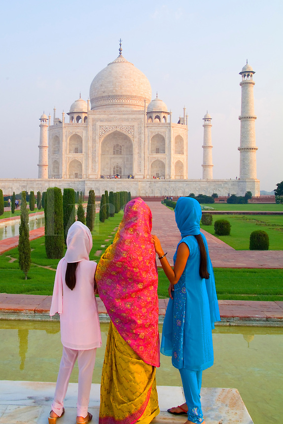 Hindu women with colorful veils visit the Taj Mahal, Agra, India