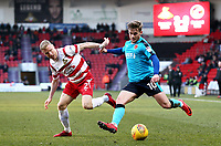Conor McAleny of Fleetwood Town battling for the all against Craig Alcock of Doncaster Rovers during the Sky Bet League 1 match between Doncaster Rovers and Fleetwood Town at the Keepmoat Stadium, Doncaster, England on 17 February 2018. Photo by Leila Coker / PRiME Media Images.