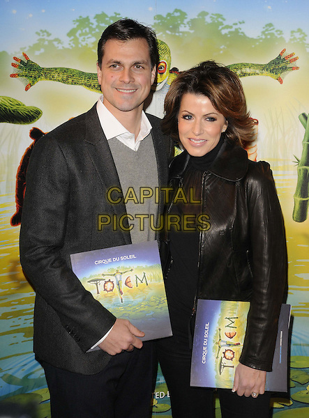 Justin Bower & Natasha Kaplinski.'Cirque Du Soleil: Totem' UK Premiere, Royal Albert Hall, London, England..5th January 2012.half length leather jacket black brown married husband wife grey gray.CAP/CAN.©Can Nguyen/Capital Pictures.