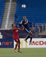 New England Revolution defender Didier Domi (3) heads the ball. In a Major League Soccer (MLS) match, Real Salt Lake defeated the New England Revolution, 2-0, at Gillette Stadium on April 9, 2011.