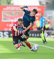 Lincoln City's Jack Payne vies for possession with Bristol Rovers' Tom Nichols<br /> <br /> Photographer Chris Vaughan/CameraSport<br /> <br /> The EFL Sky Bet League One - Lincoln City v Bristol Rovers - Saturday 14th September 2019 - Sincil Bank - Lincoln<br /> <br /> World Copyright © 2019 CameraSport. All rights reserved. 43 Linden Ave. Countesthorpe. Leicester. England. LE8 5PG - Tel: +44 (0) 116 277 4147 - admin@camerasport.com - www.camerasport.com
