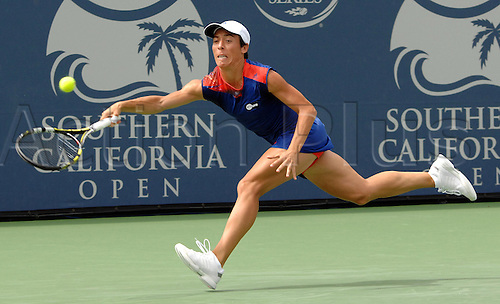 31.07.2013.la Costa Country Club, Carlsbad, California, USA.  Francesca Schiavone (ITA) reaches to make a shot during a match against Victoria Azarenka (BLR) during the Southern California Open played at the La Costa Resort & Spa in Carlsbad CA.