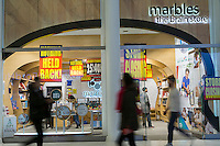 """Liquidation signs adorn the """"Marbles, The Brain Store"""" location in the Westfield Mall in New York on Friday, February 17, 2017. The chain suffered a poor 2016 and has filed for Chapter 11 bankruptcy protection and is shuttering all 37 of its stores nationwide. The company will now focus on e-commerce, wholesale and monetizing its intellectual property.  (© Richard B. Levine)"""