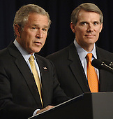 Washington, D.C. - May 17, 2005 -- United States President George W. Bush speaks after the ceremonial Swearing-in of Rob Portman as United States Trade Representative (USTR) at the Eisenhower Executive Office Building adjacent to the White House in Washington, D.C., May 17, 2005.<br /> Credit: Mannie Garcia - Pool via CNP