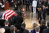 United States House Minority Leader Nancy Pelosi (Democrat of California), left, and The Speaker of the US House of Representatives Paul Ryan (Republican of Wisconsin), right, lay a wreath during the Lying in State ceremony honoring the late United States Senator John McCain (Republican of Arizona) in the US Capitol Rotunda in Washington, DC on Friday, August 31, 2018.<br /> Credit: Ron Sachs / CNP<br /> <br /> (RESTRICTION: NO New York or New Jersey Newspapers or newspapers within a 75 mile radius of New York City)
