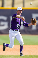 High Point Panthers third baseman Kyle Brandenburg (5) makes a throw to first base against the Coastal Carolina Chanticleers at Willard Stadium on March 15, 2014 in High Point, North Carolina.  The Chanticleers defeated the Panthers 1-0 in the first game of a double-header.  (Brian Westerholt/Four Seam Images)