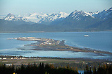 USA, Alaska, Homer, an elevated view of the Kachemak Bay and the Homer Spit with the Kenai mountains in the distance