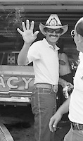Richard Petty waves Firecracker 400 at Daytona International Speedway in Daytona Beach, FL on July 4, 1983. (Photo by Brian Cleary/www.bcpix.com)