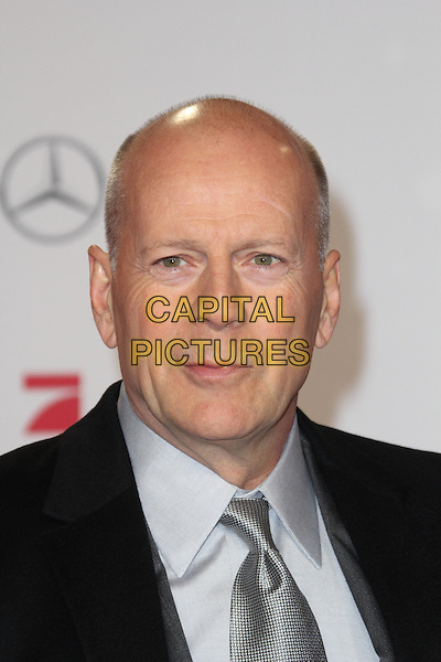 "Bruce Willis.Premiere of ""A Good Day to Die Hard"", Berlin, Germany..February 4th, 2013.headshot portrait black grey gray shirt  .CAP/UNT.©Unit2/Capital Pictures"