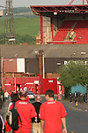 Barnsley 0 Huddersfield Town 1, 12/05/2006. Oakwell, League One Play Off Semi Final 1st Leg. Barnsley (red shirts) versus Huddersfield Town, Coca-Cola League One play-off semi-final first leg at Oakwell, Barnsley. The visitors won one-nil with a goal from Gary Taylor-Fletcher in 85 minutes. Picture shows Barnsley supporters making their way to the ground before kick-off. Photo by Colin McPherson.