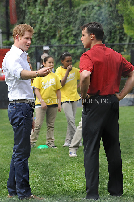 WWW.ACEPIXS.COM . . . . . .May 14, 2013...New York City....Prince Harry and Mark Teixeira visit a Harlem baseball field on May 14, 2013 in New York City. ....Please byline: KRISTIN CALLAHAN - WWW.ACEPIXS.COM.. . . . . . ..Ace Pictures, Inc: ..tel: (212) 243 8787 or (646) 769 0430..e-mail: info@acepixs.com..web: http://www.acepixs.com .