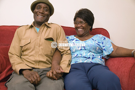 Older couple together at home; smiling,