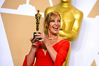 """Allison Janney, winner of the award for best performance by an actress in a supporting role for """"I, Tonya"""", poses in the press room at the Oscars on Sunday, March 4, 2018, at the Dolby Theatre in Los Angeles. (Photo by Jordan Strauss/Invision/AP)"""