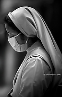 Nun Wear the mask to protect yourself from the coronavirus June 14, 2020 - Vatican City (Holy See) - POPE FRANCIS celebrates mass in the fest of the Corpus Domini in St. Peter's Basilica at the Vatican