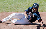 Reno Aces Wladimir Sutil slides home and scores the winning run in the bottom of the 9th inning in their game against the Tucson Padres on Monday afternoon, September 3, 2012 in Reno, Nevada.