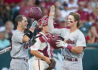 NWA Democrat-Gazette/BEN GOFF @NWABENGOFF<br /> Hunter Taylor (left) congratulates South Carolina teammate LT Tolbert after Tolbert hit a home run in the 4th inning against Arkansas Saturday, June 9, 2018, during game one of the NCAA Super Regional at Baum Stadium in Fayetteville.