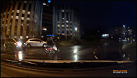BNPS.co.uk (01202 558833)<br /> Pic: JeffTaylor-Jackson/BNPS<br /> <br /> This is the terrifying moment a mobility scooter driver narrowly avoided being hit by cars after he strayed from the pavement on to a busy roundabout. <br /> <br /> In heavy rain and almost complete darkness the elderly gentleman is seen cutting across traffic to join the packed junction. <br /> <br /> Disbelieving motorists slow down for the driver, who hasn't got lights on, as he attempts to navigate the roundabout in Poole, Dorset,<br /> <br /> The incident was captured on motorist Jeff Taylor-Jackson's dash cam.