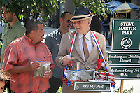 Steve Martin tapes a segment for Late Show With David Letterman selling marijuana, guns and beer at a makeshift park named after him across from the Ed Sullivan Theatre in New York City. July 11, 2012. ©RW/MediaPunch Inc.