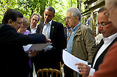 United States President Barack Obama talks with José Manuel Barroso, President of the European Commission, Chancellor Angela Merkel of Germany, Prime Minister Mario Monti of Italy, President François Hollande of France, and Herman Van Rompuy, President of the European Council, on the Laurel Cabin patio before the start of a G8 Summit working session at Camp David, Md., May 19, 2012. Mike Froman, Deputy NSA for International and Economic Affairs, listens in the background, third from left. .Mandatory Credit: Pete Souza - White House via CNP