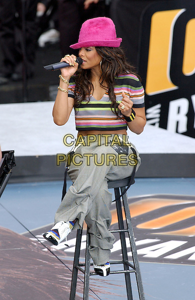 """JANET JACKSON.performs live """"On Air with Ryan Seacrest"""" to promote her new album Damita Jo held at Hollywood & Highland .2 April 2004.*UK Sales Only*.full length, full-length, grey baggy trousers, skull print, braces, midriff, stomach, belly button piercing, stripy stripes crop top, pink fedora hat.www.capitalpictures.com.sales@capitalpictures.com.©Capital Pictures."""