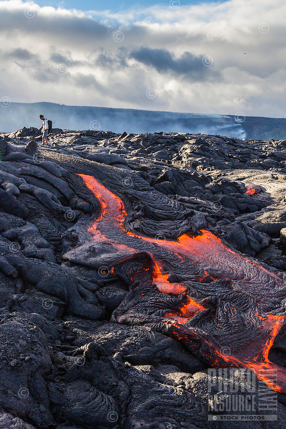 A man hikes through lava fields in Hawai'i Volcanoes National Park, Hawai'i Island.