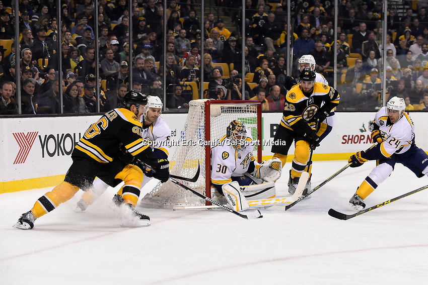 Monday, December 7, 2015: Boston Bruins defenseman Kevan Miller (86) attacks Nashville Predators goalie Carter Hutton (30) with the puck during the National Hockey League game between the Nashville Predators and the Boston Bruins held at TD Garden, in Boston, Massachusetts. The Predators defeat the Bruins 3-2 in regulation time. Eric Canha/CSM