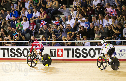 18 FEB 2012 - LONDON, GBR - Great Britain's Victoria Pendleton (GBR) (on the left in red and blue) watches opponent Australia's Anna Meares (AUS)  (on the right in white and black) during their Women's Sprint semi final at the UCI Track Cycling World Cup, and London Prepares test event for the 2012 Olympic Games, in the Olympic Park Velodrome in Stratford, London, Great Britain .(PHOTO (C) 2012 NIGEL FARROW)