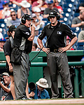 1 August 2018: MLB Umpire Brian O'Nora (left) listens to the results of a video replay called in during a game between the New York Mets and the Washington Nationals at Nationals Park in Washington, DC. The Nationals defeated the Mets 5-3 to sweep the 2-game weekday series. Mandatory Credit: Ed Wolfstein Photo *** RAW (NEF) Image File Available ***