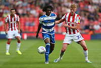 Queens Park Rangers' Eberechi Eze shields the ball from Stoke City's Sam Clucas <br /> <br /> Photographer Stephen White/CameraSport<br /> <br /> The EFL Sky Bet Championship - Stoke City v Queens Park Rangers - Saturday 3rd August 2019 - bet365 Stadium - Stoke-on-Trent<br /> <br /> World Copyright © 2019 CameraSport. All rights reserved. 43 Linden Ave. Countesthorpe. Leicester. England. LE8 5PG - Tel: +44 (0) 116 277 4147 - admin@camerasport.com - www.camerasport.com