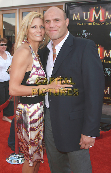 """RANDY COUTURE & GUEST.""""The Mummy: Tomb Of The Dragon Emperor"""" Los Angeles Premiere held at the Gibson Amphitheatre, Universal City, California, USA..July 27th, 2008.half length blue black suit jacket dress white purple pattern halterneck .CAP/ADM/CH.©Charles Harris/AdMedia/Capital Pictures"""