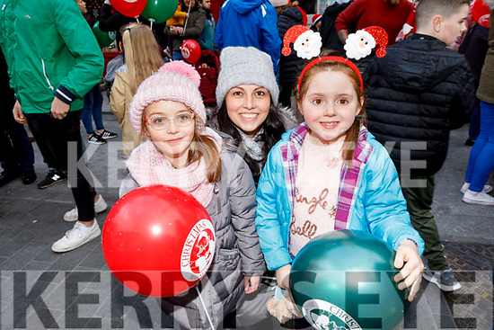 Anna Cournane, Shadine Healy and Julianna Rocha from Tralee enjoying the CH Chemist's Santa Parade on Saturday.
