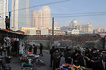 CHINA province Xinjiang city Urumqi , due to high migration of Han chinese the muslim uyghur people are a minority today, the old uyghur town is demolished and replaced by new building towers / CHINA Provinz Xinjiang , Stadt Ueruemqi , in Urumqi lebt das muslimische Turkvolk der Uiguren, durch massive Zuwanderung von Han Chinesen nur noch eine Minderheit