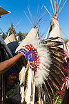 Louis Sweowat of the Yakima Tribe showing his traditional garb, some of which has been handed down for generations.  He is pictured at the Indian Village, a gathering place filled with some 300 Tee Pees where members of the Confederated Tribes of the Umatilla gather each year for the Pendleton Round Up events.